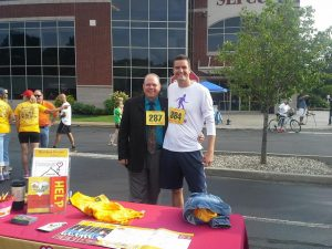 Roohan Realty's Gerard Wise (Commercial Real Estate) poses with McDonald's Owner Roger Grout at this year's SEFCU Labor Day 5K