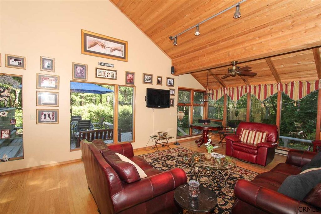 Family room with walls of windows and views at 39 loughberry lake road