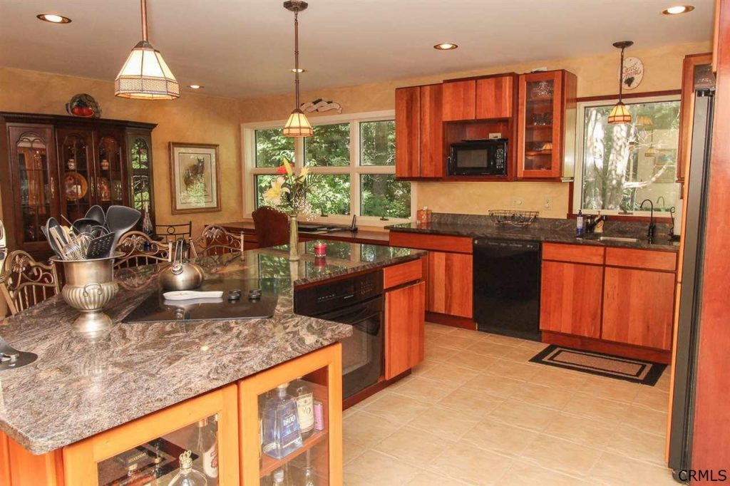 updated and modern kitchen with island, granite and maple cabinets at 39 loughberry lake road