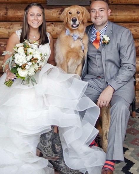 Oliver, Sara and their Golden Retriever pup, Charlie, celebrate Oliver and Sara's wedding day