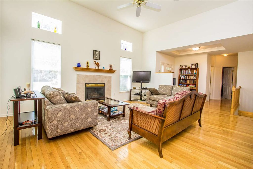 17 Donegal Way, Wilton, NY has vaulted ceilings, hardwood floors and a gas fireplace