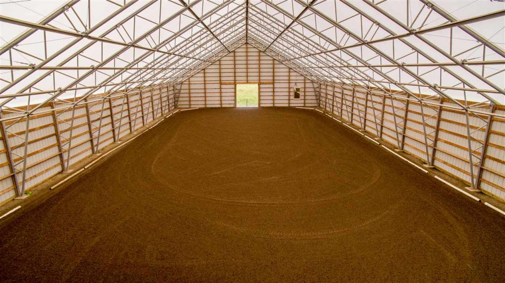 287 Jones Road, hartwick ny is a farmhouse for sale featuring an indoor riding arena