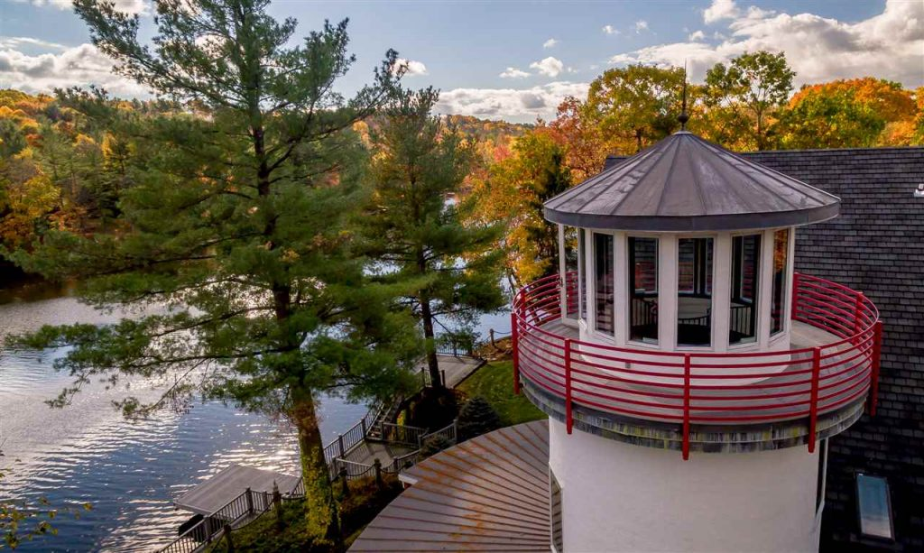 194 westside drive is a waterfront home on ballston lake with an attached lighthouse and spectacular views
