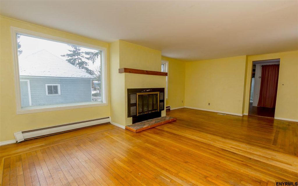 11 Bensonhurst Ave in Saratoga Springs is a 1,015 sqft home for sale with 2 bedrooms, 1 bath, fireplace and hardwood floors