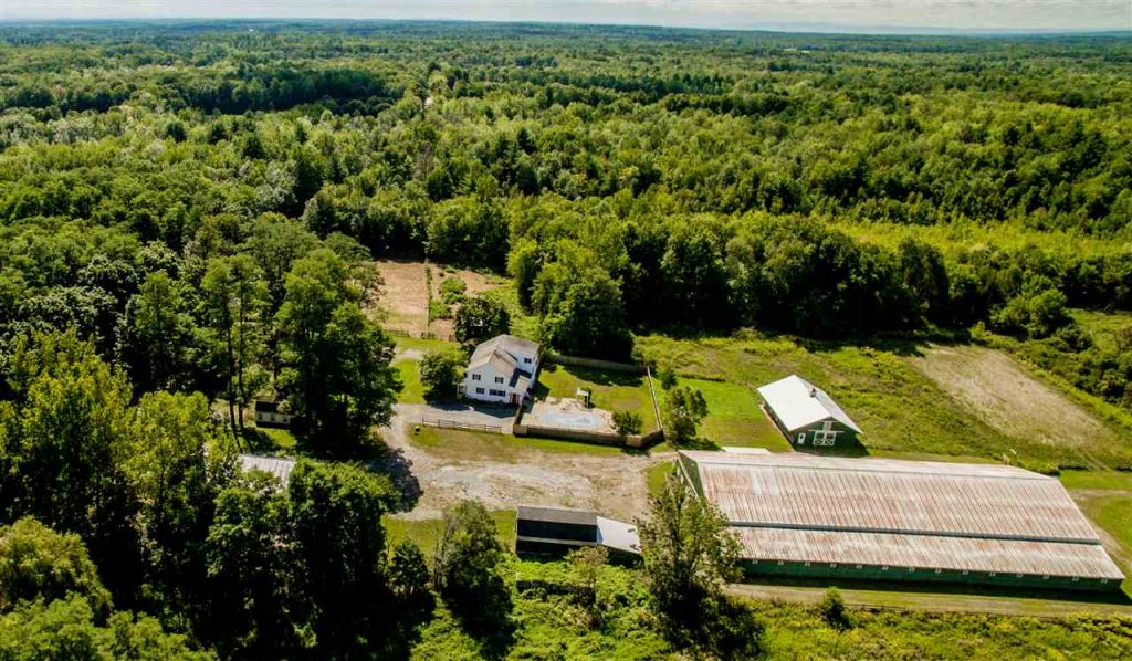 161 White Road is a horse farm for sale in Milton, NY with 17 acres, 3 barns, 40 paddocks and a 7 bedroom home