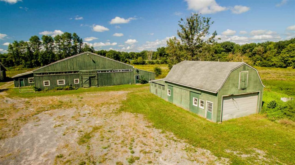 161 White Road in Milton, NY is a horse farm for sale with an indoor arena, 3 barns, 40 stalls and tack room