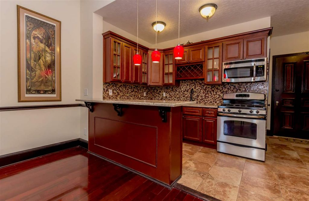 spring street condo for sale in downtown saratoga springs, ny with modern kitchen, quartz and stainless steel appliances