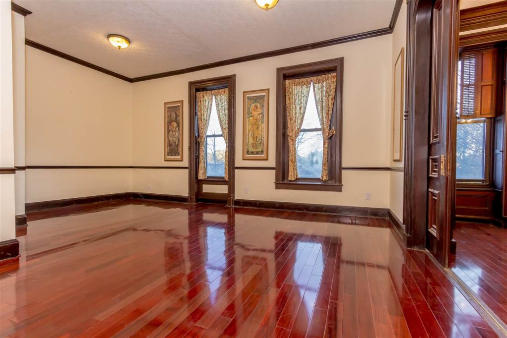 spring street condo for sale in downtown saratoga springs, ny with original trim, moldings and pocket doors