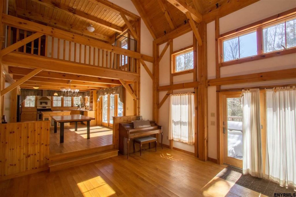 3056 Shaw Road in Galway, New York is a beautiful custom post and beam home with open floor plan and high ceilings