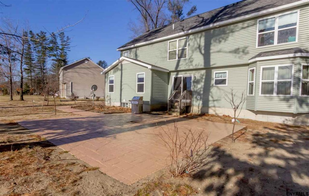 12 Wyndham Way in Ballston Spa, NY is a home for sale with a beautiful stamped concrete patio