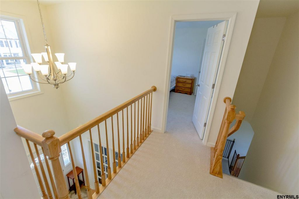 25 Maiden Circle in Malta New York has a grand foyer, open stairway and lots of natural light