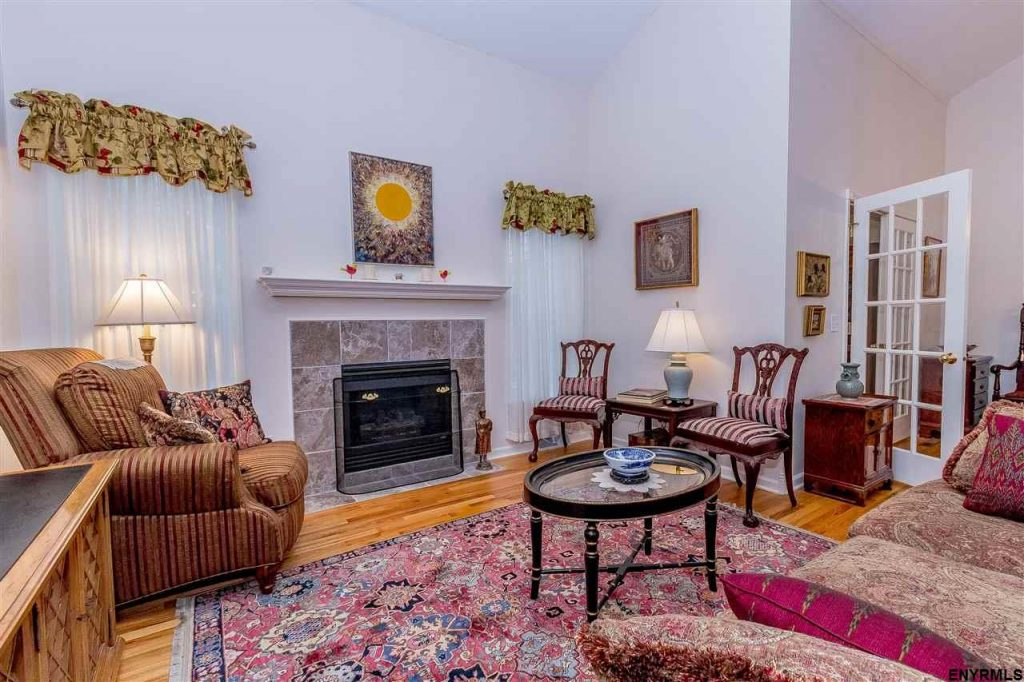 19 donegal way is a townhouse for sale in saratoga springs, new york with hardwood floor and a gas fireplace