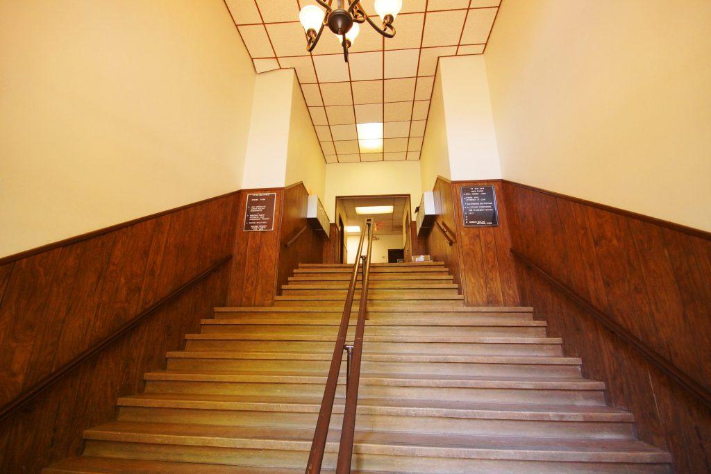 An interior stairway at 77 Van Dam Street in Saratoga Springs New York