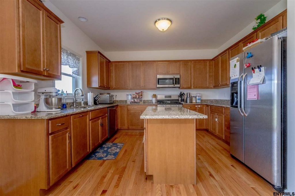 25 Maiden Circle in Malta New York has a beautiful, modern kitchen with center island, butler's pantry, convection oven and granite counters