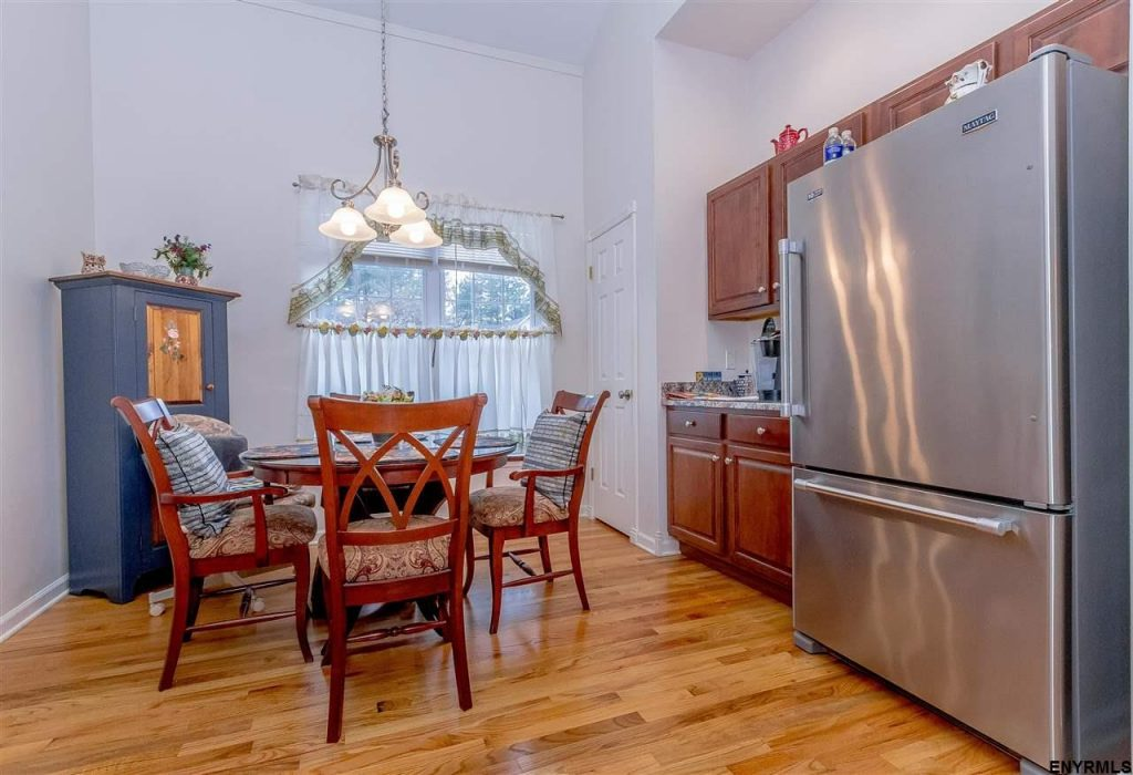 19 donegal way is a townhouse for sale in saratoga springs, ny with an updated kitchen finished with stainless steel appliances