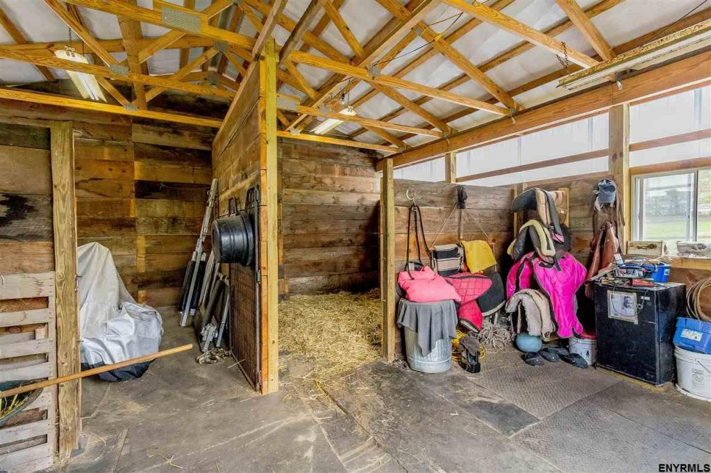 154 Blanchard Road is a boutique horse farm for sale in saratoga county ny with fenced paddocks, 2 run-in sheds, automatic waterers, a 2 stall barn with tack room, round pen, storage shed and electric fences