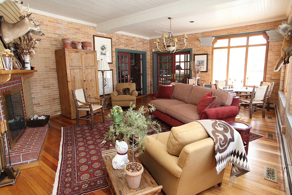 55 myrtle street in saratoga springs ny is a home for sale with an Adirondack room, brick walls and fireplace