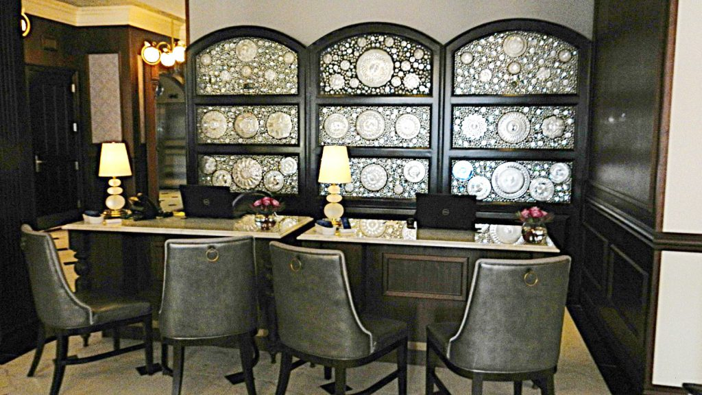 """Dinner plates from the original hotel are incorporated into the decor of the """"new"""" Adelphi's reception area"""