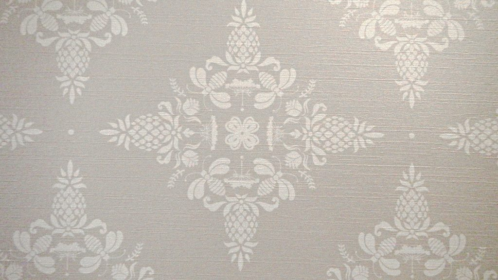 Wallpaper used in the Adelphi reflects the hotel's philosophy: the pineapples signify hospitality, and the bees represent sustainability