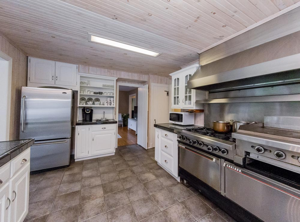 33 Garrison Rd, in Queensbury is a home for sale with a chef's kitchen equipped with professional grade stainless steel appliances and tile floors