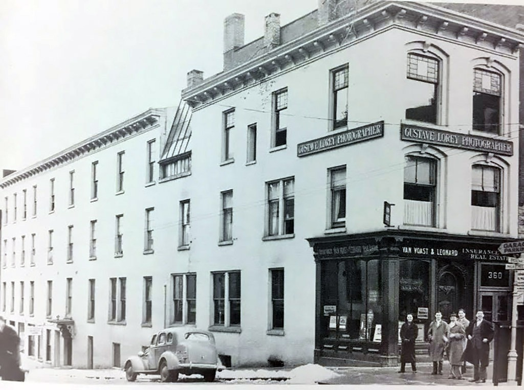In 1904, Van Voast and Leonard Insurance Company opened its doors on the first floor for business. The skylight, added for natural light for artists and photographers on the third floor of the building in 1888, is shown. Photo taken circa. 1932.