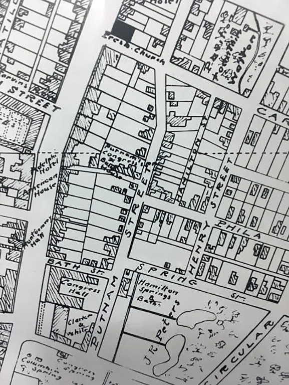 Before the fire in 1865, Phila Street did not connect with Broadway. Phila Street ended at Putnam and there was a narrow alley that lead from Putnam to Broadway as shown in this recopied map from circa 1850s.