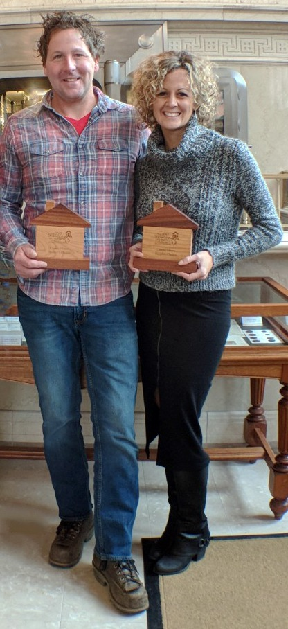 Matt and Jaime McPadden of McPadden Builders accept the awards for REALTORS® Choice and People's Choice