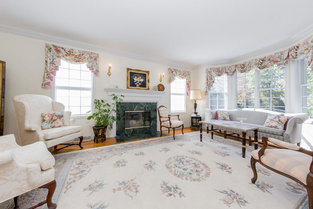 12 Crimson Oak Ct in Niskayuna is a home for sale with a beautiful formal living room with hardwood floors and fireplace