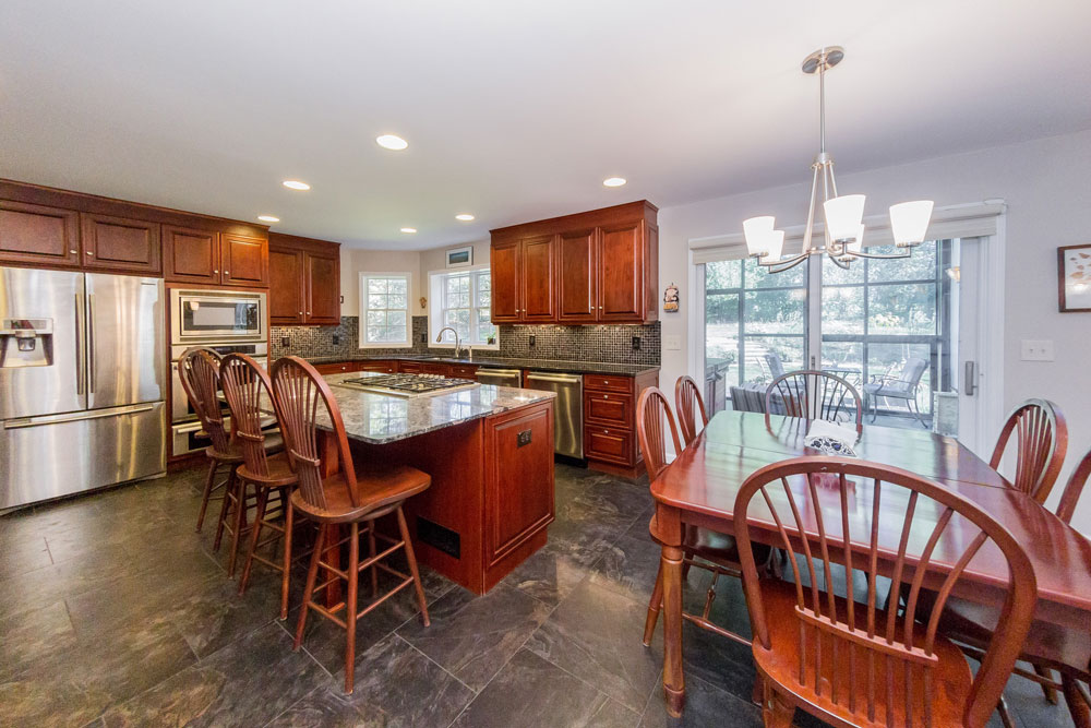 12 Crimson Oak Ct in Niskayuna,, is a home for sale with an open kitchen with granite counter tops and stainless appliances