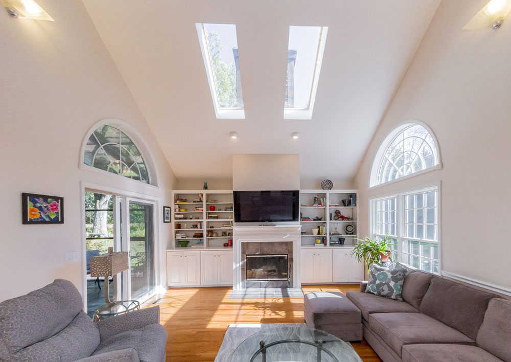 12 Crimson Oak Ct in Niskayuna is a home for sale with a family room with cathedral ceiling, skylights and hardwood floors