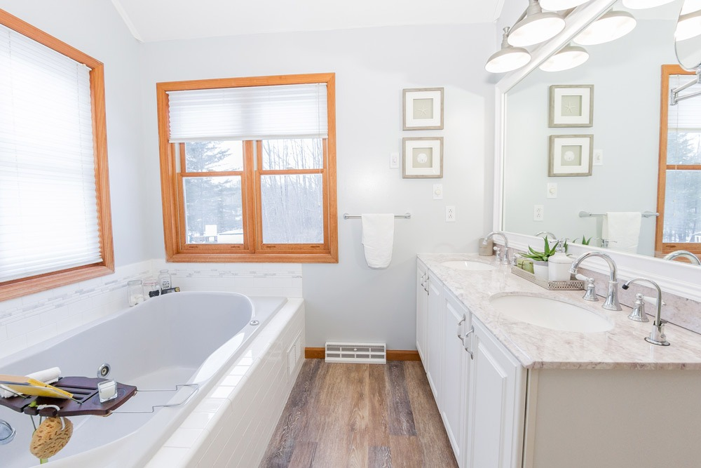 2203 rowley road in malta ny is a home for sale with a beautiful master bath and tons of natural light