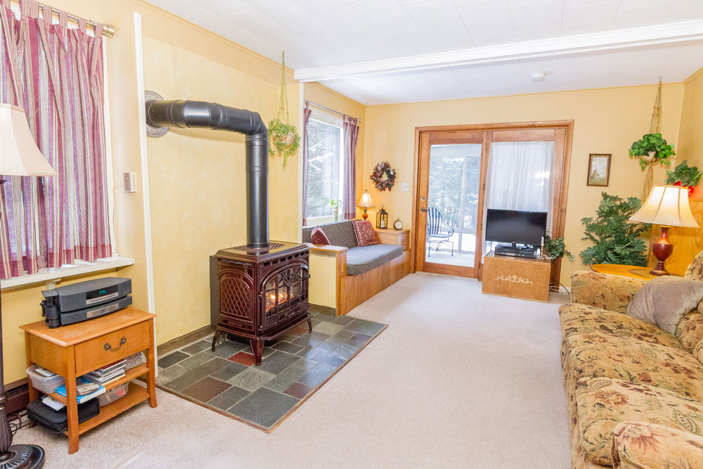 358 Wilton Road in Greenfield, NY is a home for sale with a gas fireplace and screened in porch