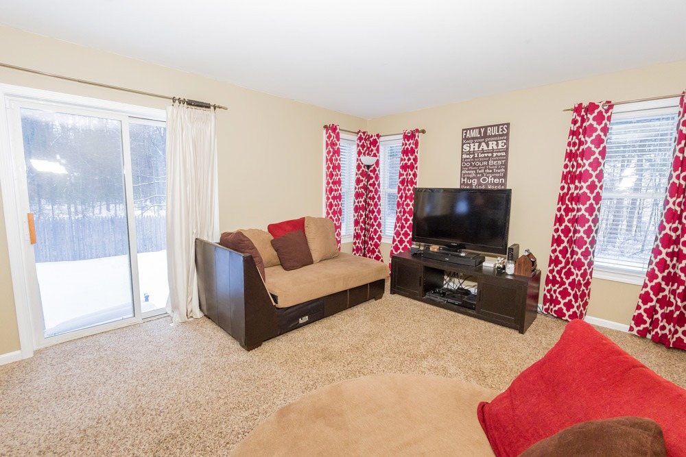 466 Colebrook Road in Northumberland, NY 12831 is a single family home for sale with bright living room with sliding doors to backyard