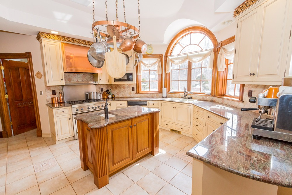 2626 Donnan Road in Galway, NY 12074 is a luxurious Saratoga County home for sale with a large gourmet kitchen and granite counters and tile floor
