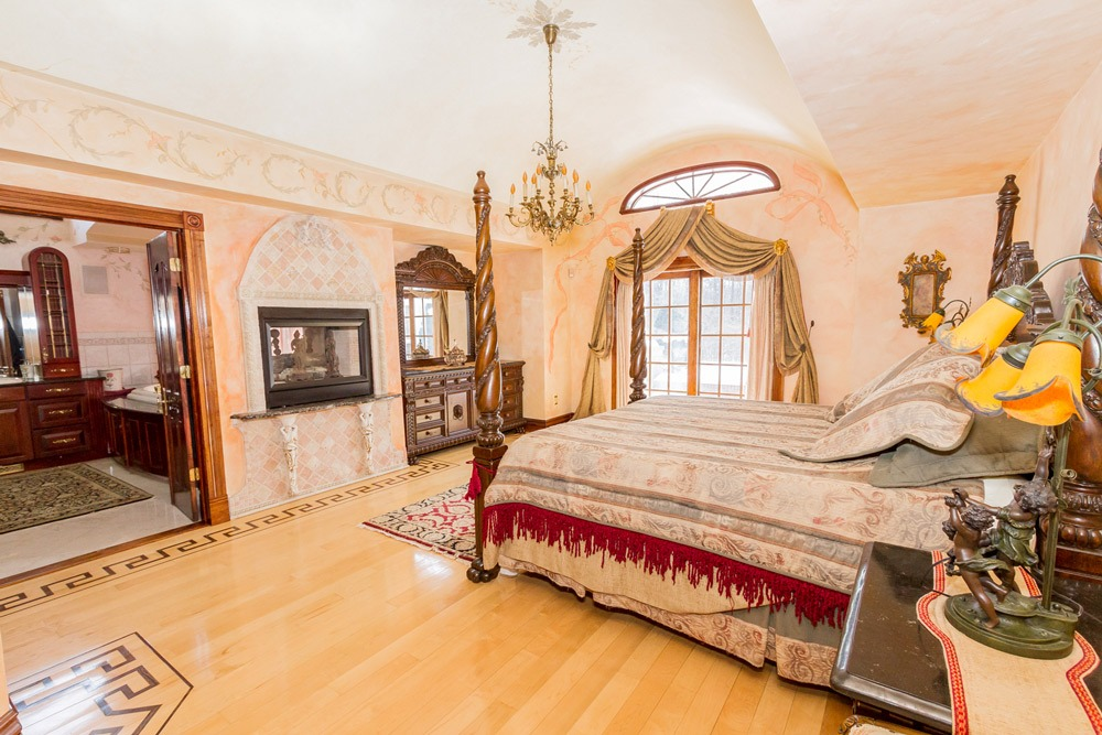 2626 Donnan Road in Galway, NY 12074 is a luxurious single family home for sale in Saratoga County with beautiful first floor master suite with hardwood floors and two-sided fireplace