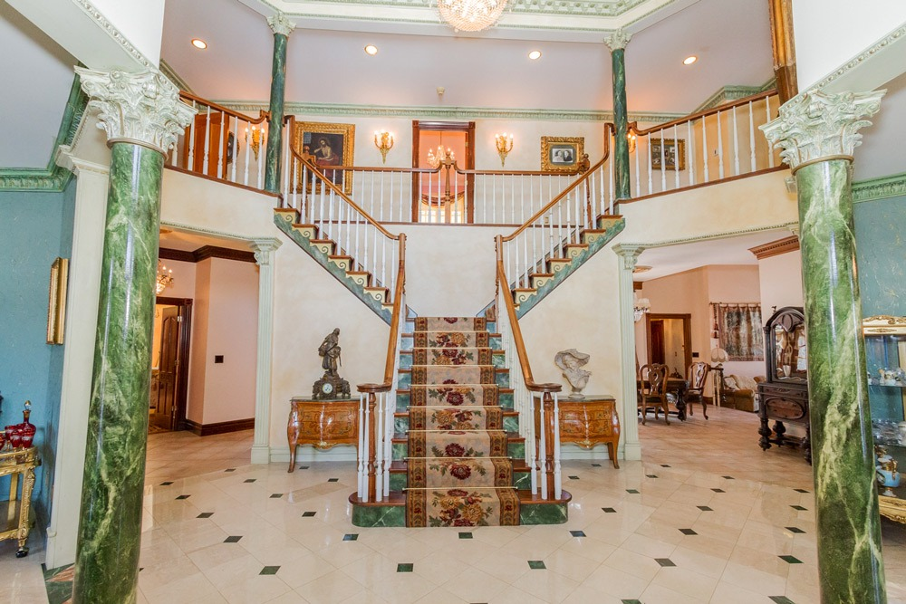 2626 Donnan Road in Galway, NY 12074 is a luxurious estate for sale with beautiful grand staircase in the entryway