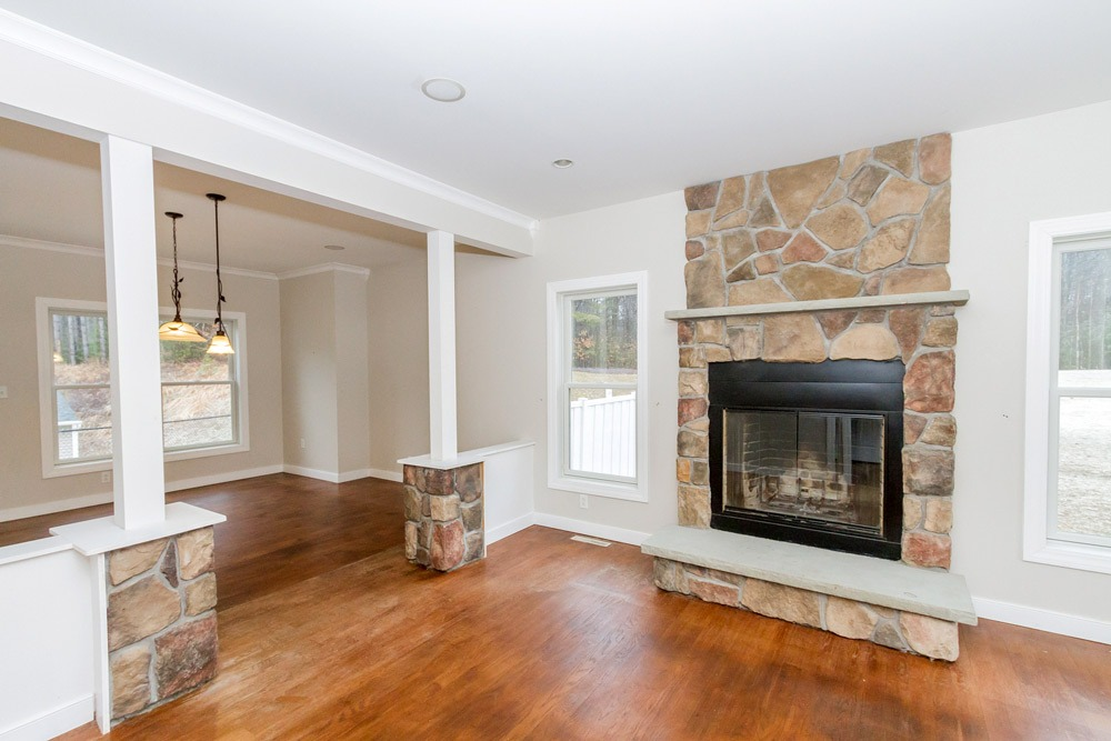 8 Garnet Mine Court in Moreau, NY features formal living area with fireplace and hardwood floors