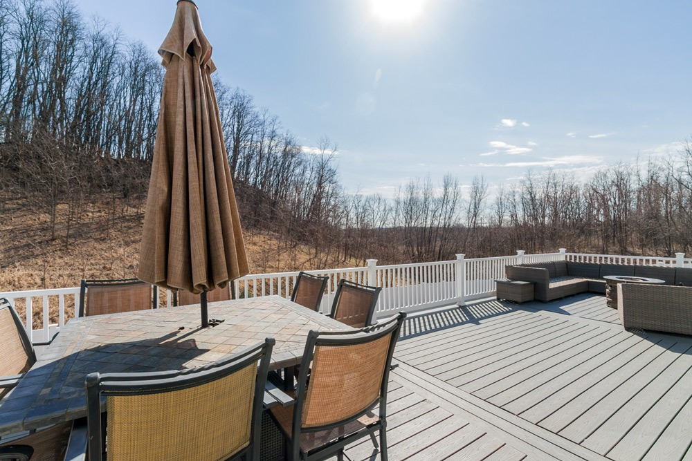 15 Trevor Court in Clifton Park has a beautiful wraparound deck with forever wild views