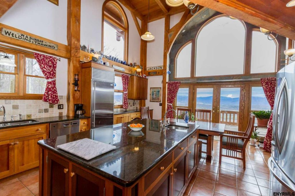 61 Fire Tower Road in Cambridge, New York is a custom Post and Beam home for sale with open floor plan and spectacular views.