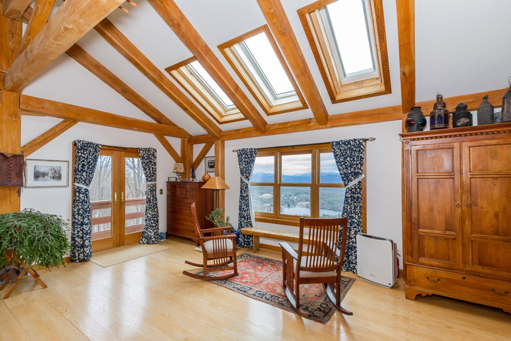 61 Fire Tower Road, Cambridge, New York 12816 features a master bedroom with hardwood floors and skylights