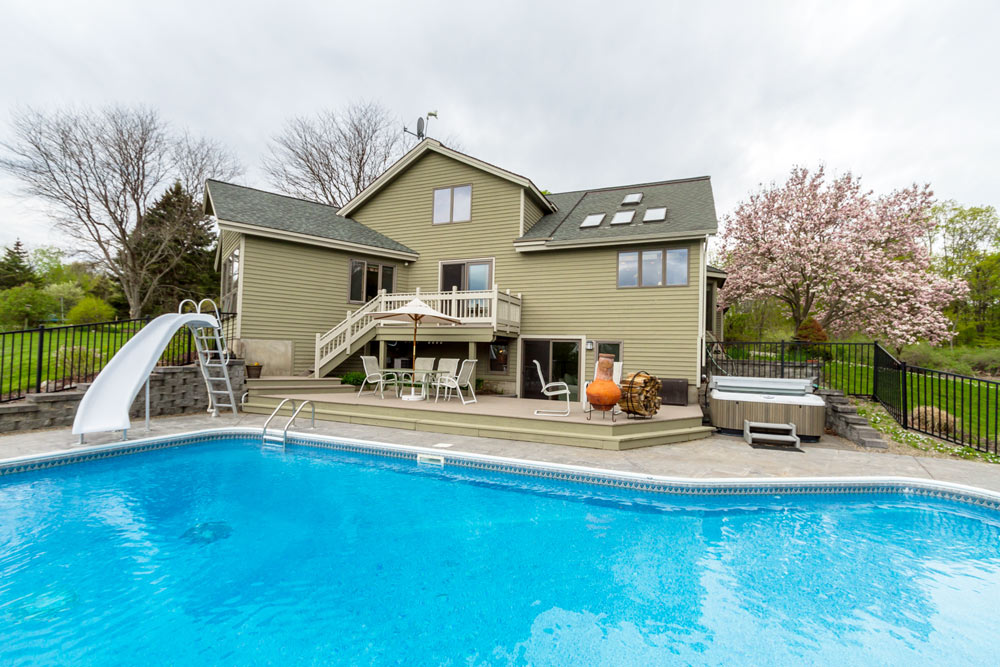 5742 Jockey Street is a home for sale in Galway, NY with fantastic outdoor living space including an inground pool and hot tub