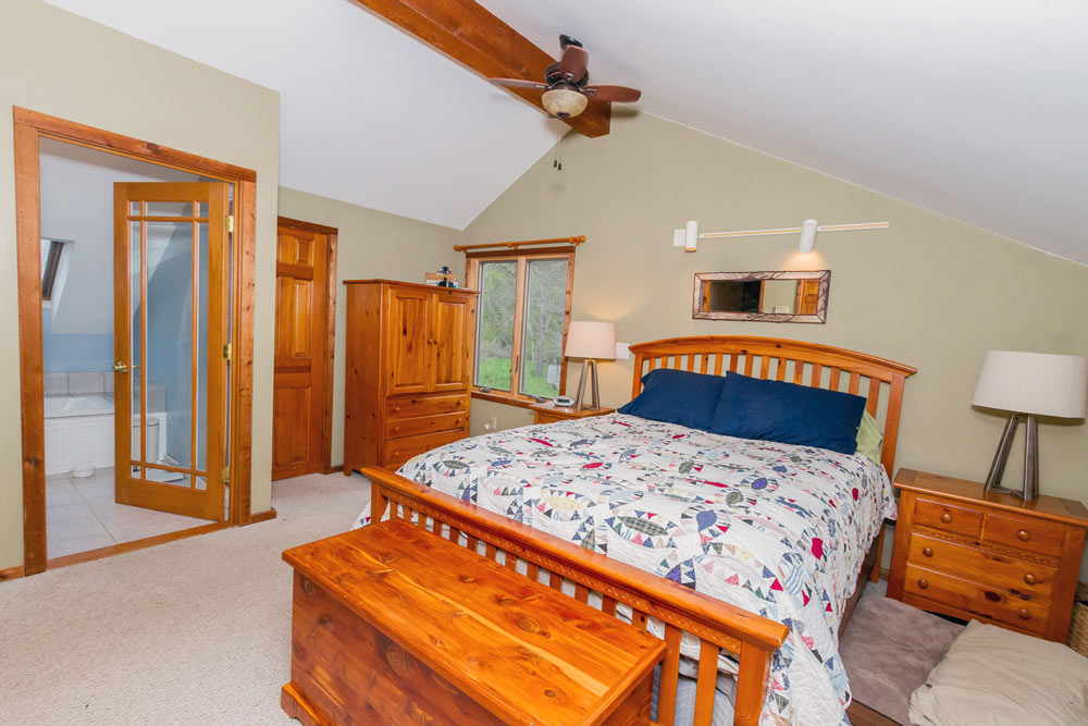5742 Jockey Street is a home for sale in Galway, NY with a master bedroom with ceiling fan and en suite
