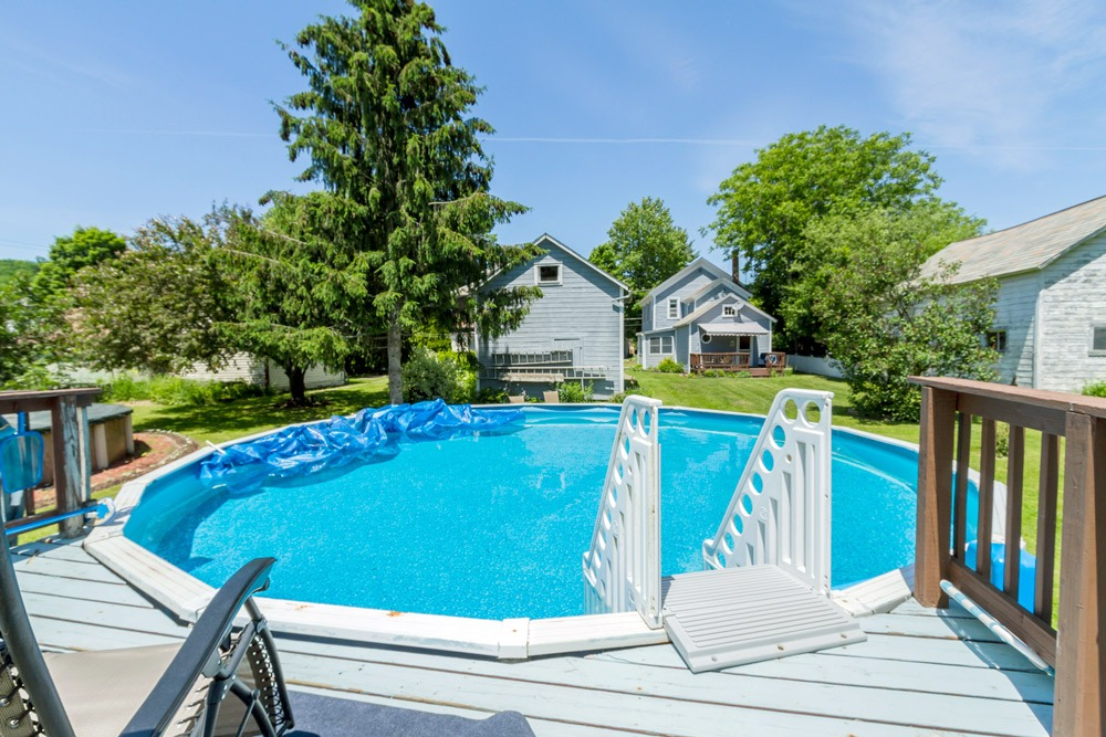 6 Nichol Street is a home for sale in Salem, NY with a large back yard with above ground pool, back patio and detached barn