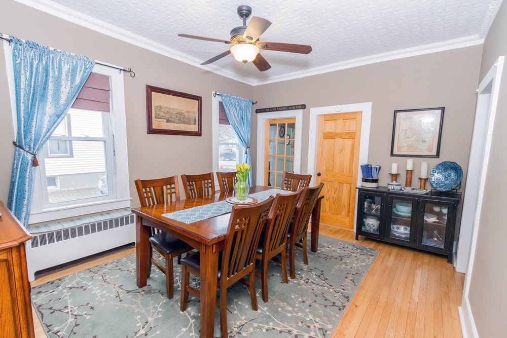 6 Nichol Street is a home for sale in Salem, NY that features a large dinning room with a beautiful tin ceiling