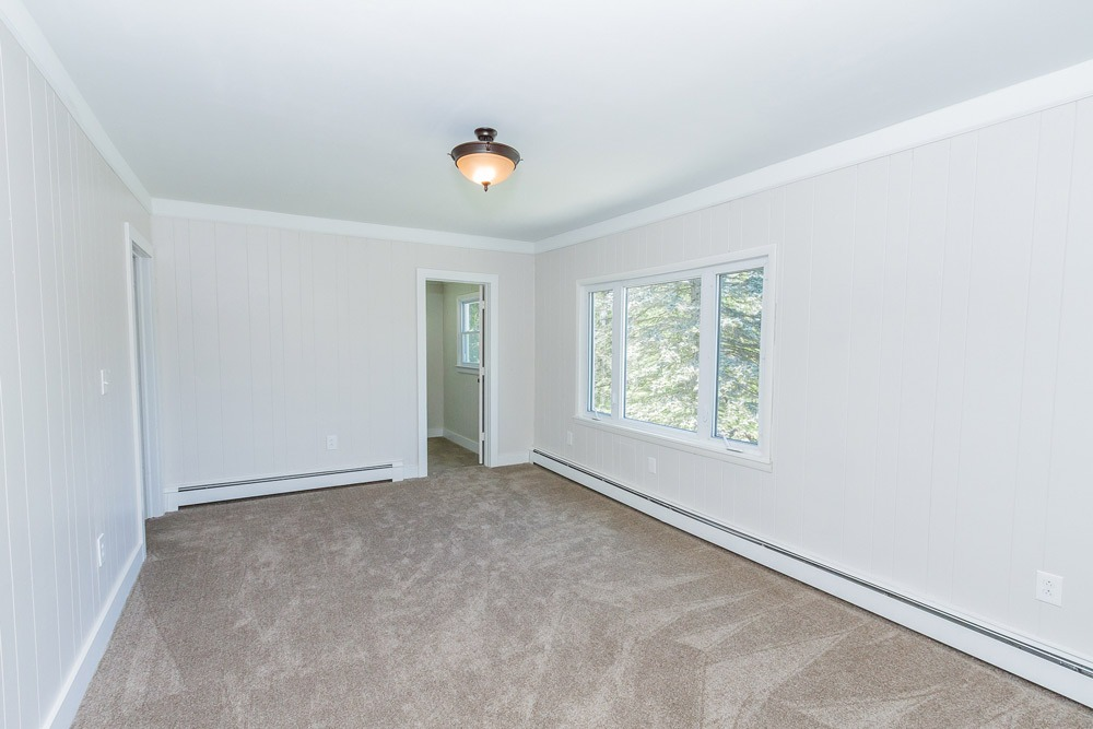 153 Meehan Road, Stillwater, NY is a home for sale with a master bedroom with walk-in closet and en-suite bathroom