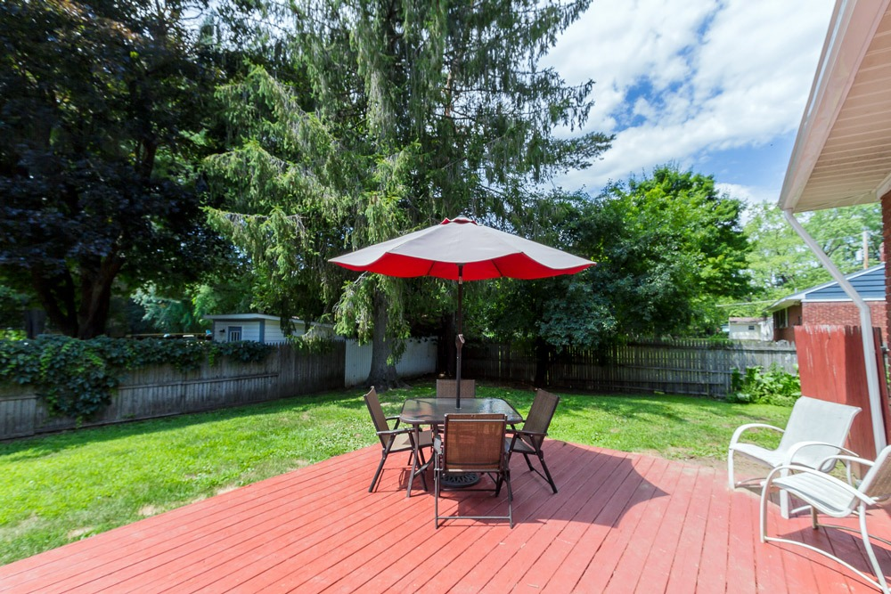 27 Kirby Road, Saratoga Springs, NY is a brick ranch for sale with a fenced in yard and back deck