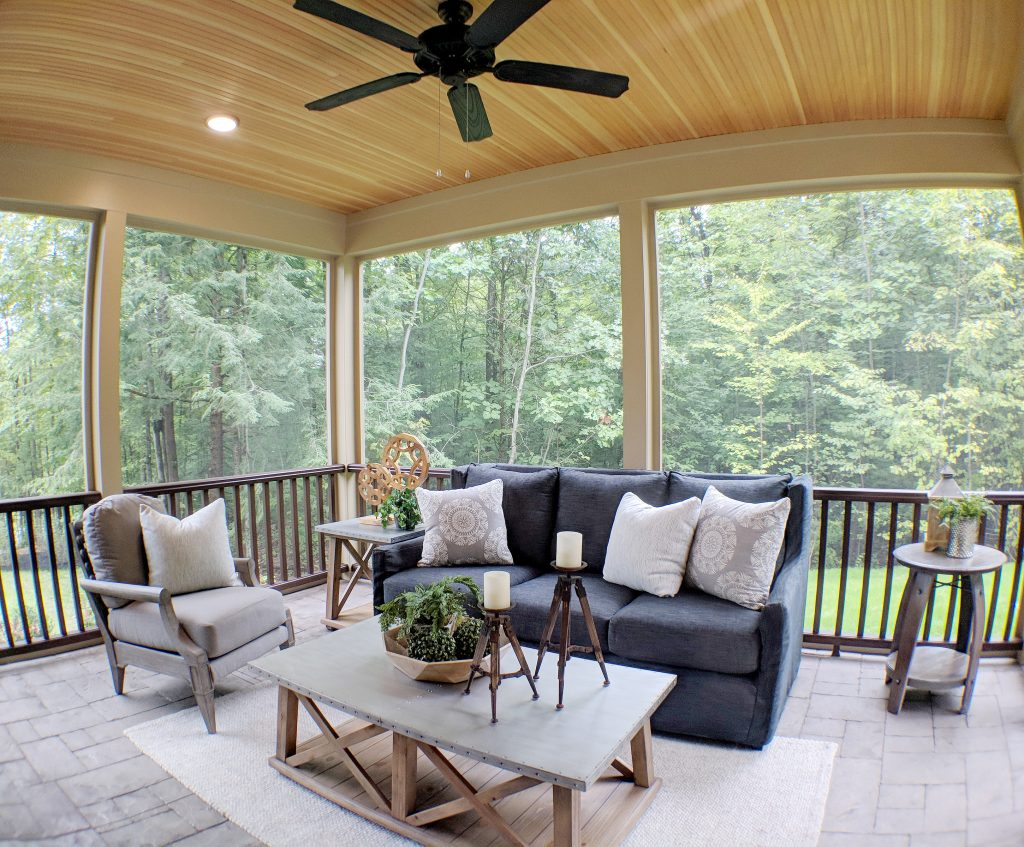 Walk out of the living room and onto to the screen porch finished with a low-maintenance, highly-durable stamped concrete floor