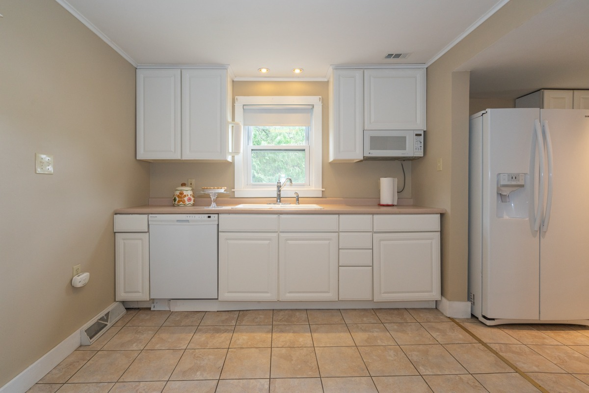 12 Combs Avenue in Hudson Falls, NY is a home for sale with an eat-in kitchen and tile floors