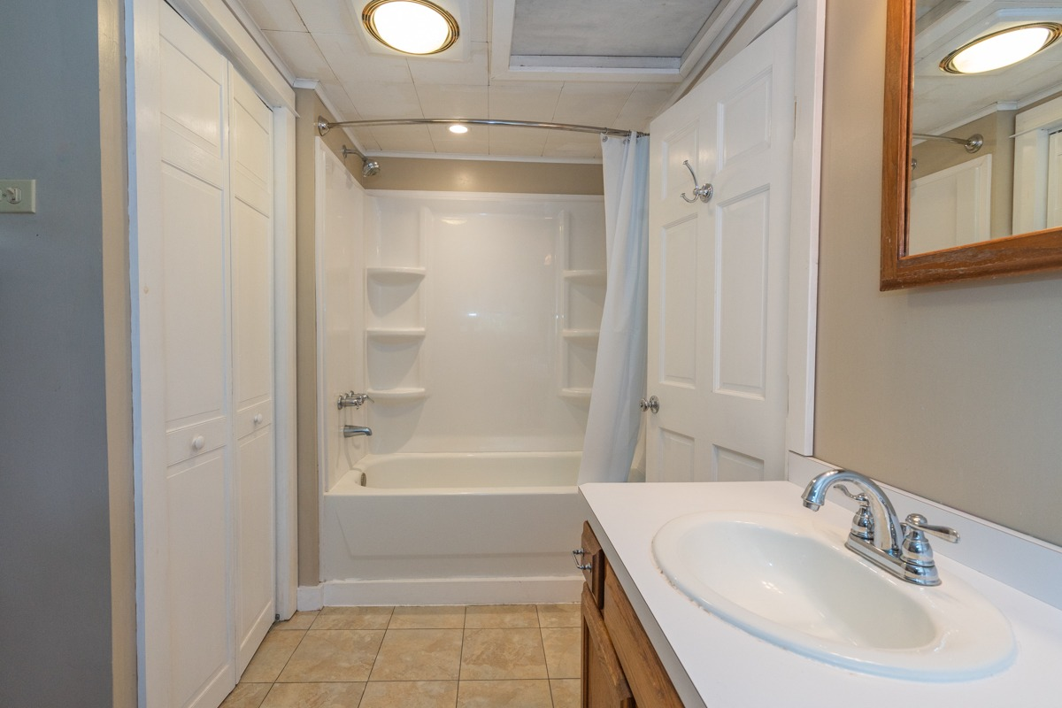 12 Combs Avenue in Hudson Falls, NY is home fore sale with a large full bathroom with linen closet and tile floor