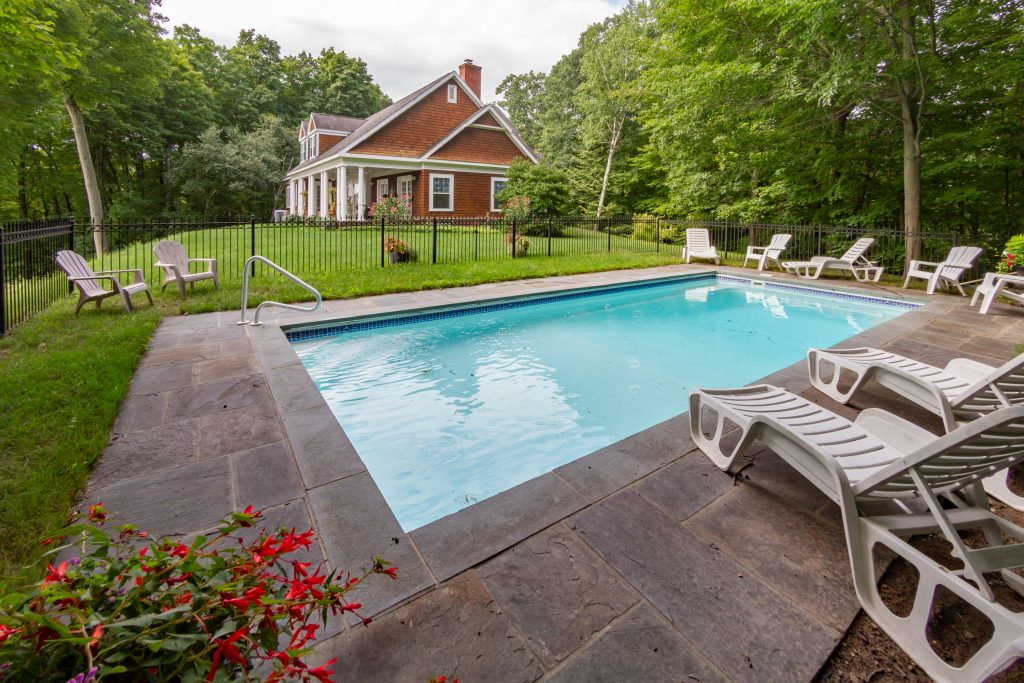 139 Burke Road, Saratoga, NY is a Robert A.M. Stern designed home for sale with in-ground pool and stone deck